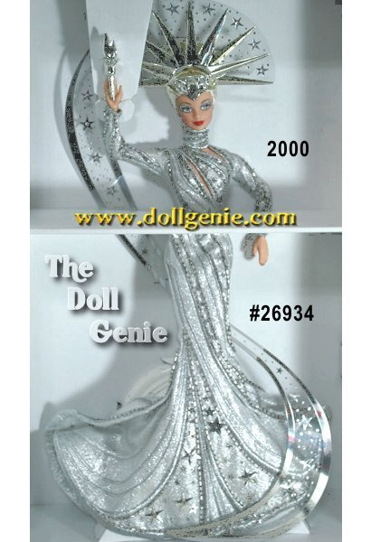 Limited Edition - Bob Mackies latest masterpiece commemorates a classic American landmark and features his trademarks a dramatic headpiece, heavy beading and embroidery, and over-the-top fantasy glamour. Lady Liberty Barbie doll is dressed in a fitted silvery metallic gown with long sleeves and a sweeping train at her feet. Slivery embroidery, bugle beads, and silvery star sequins accent her lovely flowing gown. She wears an elaborate headpiece, the beginning of a clear sweep of sparkling rhinestones and stars that circle her length. Shining from head to toe, her feet are graced by silvery pumps. In her right hand, she holds a silvery torch. Barbie and the Statue of Liberty, two symbols that stand for all things American!