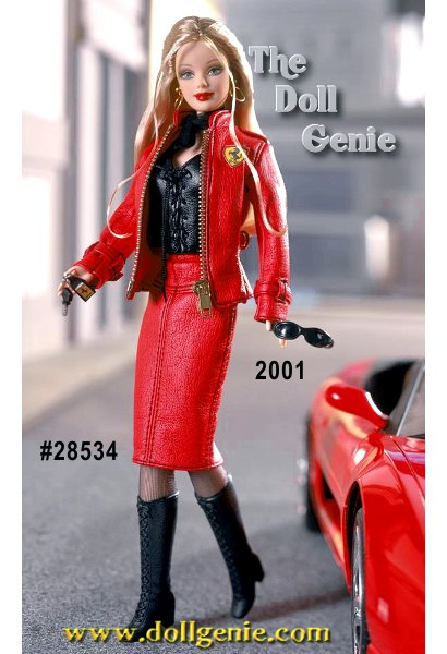 Limited Edition - Two of the worlds most popular brands have joined forces once again to bring you the essence of cool. Ferrari Barbie is ready to drive off in style in her fabulous red faux leather suit adorned with the Ferrari logo on the left side of her jacket. Her suit is complemented with black stitching and a golden working zipper. Under her suit she wears a black faux leather halter top that is laced up the front. To complete the look she wears black boots and long golden blonde hair. She comes with her own Ferrari key chain. $149.95