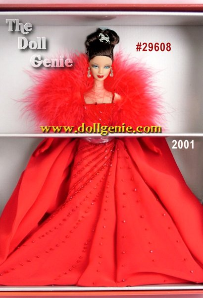 This is the only Limited Edition Barbie doll that embodies the glamour of the Ferrari name and the lifestyle associated with these magnificent motorcars. Barbie doll pays tribute to her favorite car, Ferrari, wearing a sophisticated red evening ensemble that shimmers with Swarovski crystals. The gown is exquisite down to the last detail, from the delicately beaded straps to the dramatic, flowing skirt. To accessorize the look, Barbie wears a soft stole trimmed with marabou, long red gloves and Swarovski crystal drop earrings. Her brown hair is styled in an intricate updo and finished with a silvery hair ornament in the shape of the Ferrari horse.
