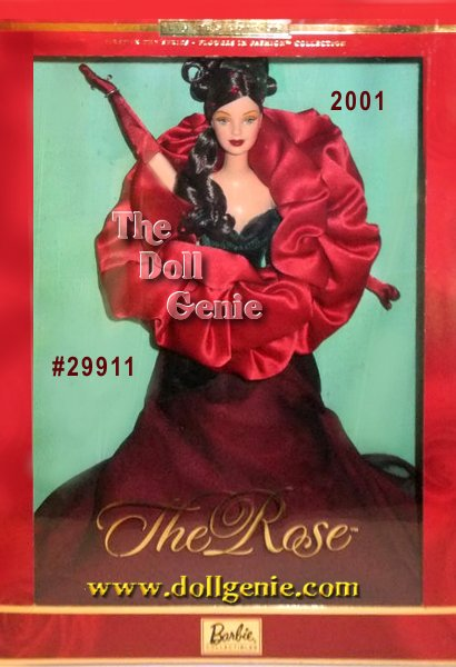 The Rose reinvents Barbie doll as an extraordinary, red blossom. She wears a full-length gown of deep red chiffon with a red/green iridescent velvet bodice and green velvet leaves featuring an embossed leaf print pattern. Resembling softly shimmering petals, the ruby red satin bodice swirls and folds, encircling and embracing Barbie. Rich red rhinestones sparkle on the skirt as fresh dew drops. A romantic headdress of velvet leaves and rhinestones, dark red gloves, and shoes are the final perfect complements to this extraordinary creation.