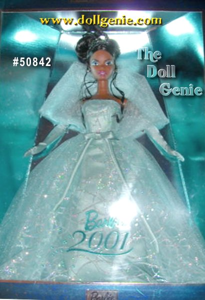 Second in a series that celebrates the first decade of the new millennium, Barbie doll looks magnificent in a dazzling organza gown and tiara. Barbie long, full dress is accented at the waist with a satin bow and finished with scallop edging at the hem. To complement her gown, Barbie wears matching seafoam colored evening gloves and pumps. Her finishing touches are crystal drop earrings and a special rhinestone tiara that reads, 2001 - Barbie designed by Robert Best