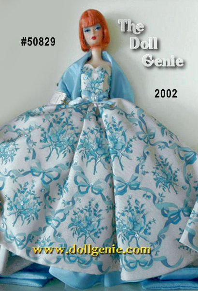 Provencale Barbie doll turns heads in this exquisite floor-length ivory gown with pale blue detailing and a blue tulle underskirt with taffeta trim. A flowing pale blue stole drapes her shoulders, complementing her striking red hair, styled elegantly in a page-boy reminiscent of her ancestors. A finishing touch to her outfit with blue opera gloves.