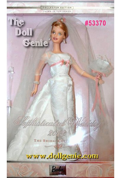 Wearing a floor-length gown with a satin bodice and slim skirt of ivory jacquard with a matching train, Barbie doll looks positively enchanting! Her golden blond hair is styled into an elegant upsweep, topped by her long veil with a pale pink bow at the crown. Soft makeup and a bouquet of lilies add the fabulous finishing touches.