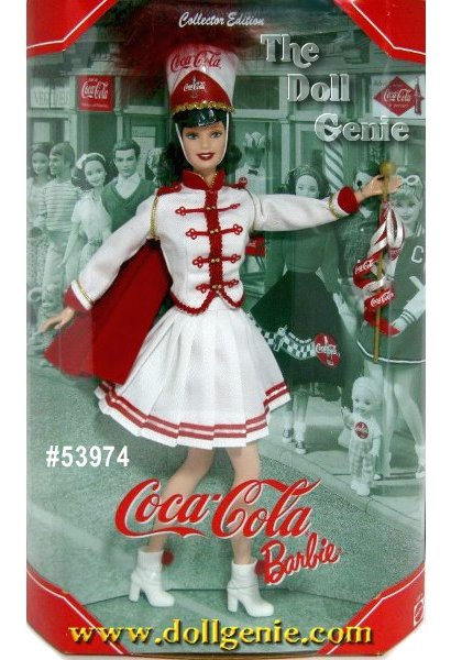 Make way for COCA-COLA Barbie doll! She is dressed and ready to lead the band in this adorable Majorette costume featuring a white tailored jacket with golden button and matching short pleated skirt with red accents and a red cape. A tall hat with the COCA-COLA script trademark and red marabou accents tops her beautiful brunette hair, and white half-boots with red pom poms adorn her feet. She holds a golden baton with ribbons in her hand.