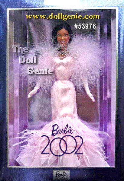 Dressed in a sensational pink glittery fitted gown with dramatic ruffles and a flared hem of ruffles and feathers, this African American Barbie celebrates the year 2002. Her outfit comes with a coordinating pink marabou stole, full-length pink gloves, and pink high heel shoes. Accessories include silvery stud earrings, and a matching necklace that reads 2002.?African American Version