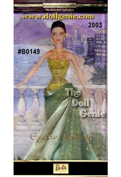 Exotic Beauty Barbie doll wears a gown of green satin with a strapless golden and green jacquard bodice. The skirt is draped to one side and layered with golden glitter encrusted green tulle. Her black hair is pulled back in a low chignon, and golden dangling earrings and necklace enhance her tan skin.