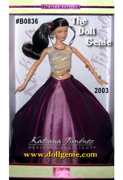 Limited Edition - Barbie dolls top is a golden woven fabric with golden and purple beads at the hem. It ties in the back and reveals her midriff. Her skirt is an eggplant purple taffeta with pleat detail. It opens in the front to reveal a front panel, which is a pinkish lavender shantung with an Indian inspired golden print hem. Her earrings are golden hoops with beads and she wears and interesting arm bracelet made out of golden wire that swirls around her arm. Barbie dolls hair is a rich dark brown with auburn highlights, done in a low side ponytail with a purple velvety flower in it.