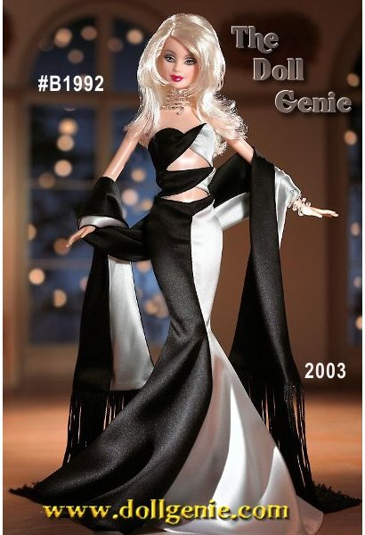 Limited Edition - In a city known for decadence, Noir et Blanc Barbie doll will make heads turn in this exquisite ensemble. Her striking black and white gown wraps across her torso in two sections, and dramatically flares at the bottom. A long shawl with black on one side and white on the other features long black fringe. She swears sleek serpentine jewelry a beaded wrap necklace and bracelet, and her ensemble is completed by a pair of black and white strappy heels. Fantastic face paint, and luxuriant long blond hair add the finishing touches to this decadent doll. Sensationally stylish. A vision of loveliness for a night out in The Big Easy.