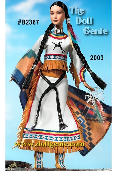 Spirit of the Sky Barbie doll captures the powerful magic and proud heritage of a Native American woman. She wears a two-piece white ensemble. Her top has a single horse on the front and a pattern of different colors around the neck and midriff. Shirt and skirt are adorned with tan suede fringe. Her coordinating skirt is tied with a black belt. She wears matching tan suede boots with matching trim that adorns her blouse. Barbie dolls hair is styled into 2 long, thick braids, each held in place with silvery accessories. She also has 3 feathers in her hair. Finally she wears a dramatic necklace that completes her Native American look.