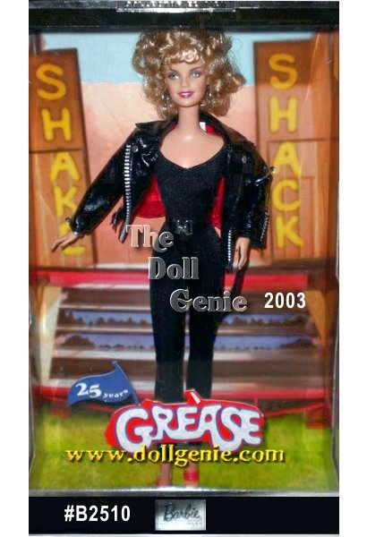 In celebration of the 25th anniversary of the beloved movie Grease, Barbie doll portrays the character Sandy Olsson. She wears a sassy re-creation of the outfit from the memorable final scene of the movie. Ready to re-capture Dannys attention and his heart, the once prim and proper Sandy is dressed for maximum effect! A black faux leather jacket tops her sleek jumpsuit, cinched by a matching belt with silvery buckle. She tops off her ensemble with curly sandy blond hair, kicky red heels, and silvery hoop earrings. Twenty-five years later, Grease is still the word!