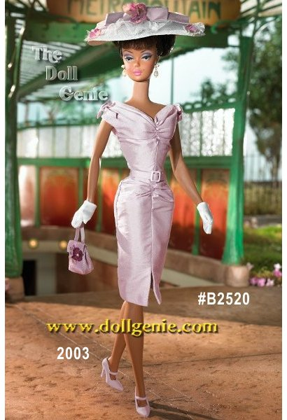 The second African-American doll in the Barbie Fashion Model Collection, Barbie doll looks lovely in a lilac shantung sheath dress. Her dress is accented with a slit at the front, small bows at the shoulders, and self-belt. Her accessories include a white straw cloth hat with white tulle, lilac shantung bow, and lilac flowers. She also has short white gloves, faux pearl drop earrings, and lilac heels. Doll cannot hold purse as shown. Barbie Designed by Robert Best