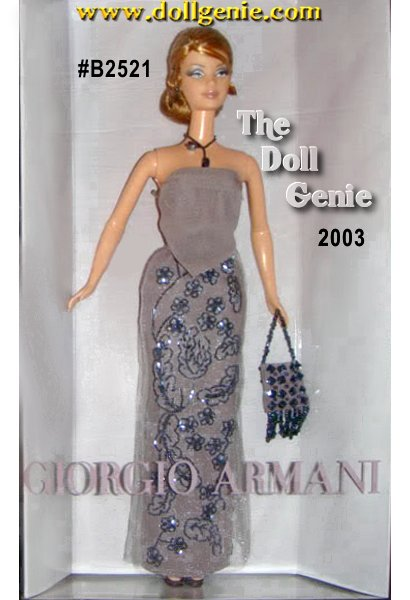 Armani Barbie doll wears an elegant re-creation of an original Giorgio Armani gown. Her strapless, silk chiffon  top is paired with a skirt of crepe and sparkle tulle. Intricate beadwork lends sophisticated glamour to the long skirt. She carries an evening purse of taupe crepe embellished with crystals. The perfect final accessories are hematite earrings and necklace.