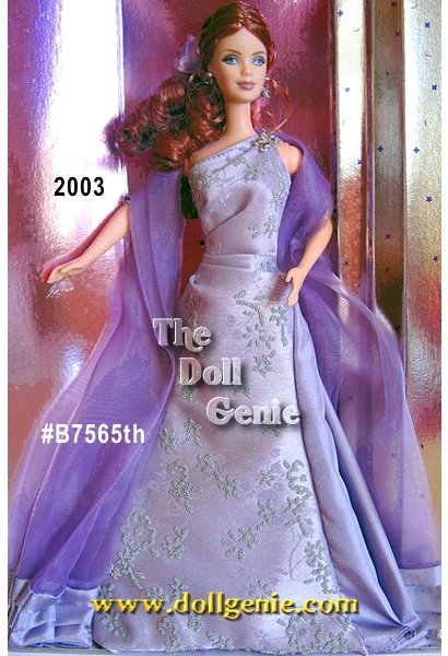 This Treasure Hunt redheaded version of Barbie 2003 was limited to 2500 dolls worldwide. She wears a lavender gown that goes over one shoulder to create an elegant look. The bodice of the gown has shiny, silvery caviar beading. She also wears a dark lavender organza floor length wrap trimmed at the bottom with taffeta. Her hair is pulled back into an elegant low ponytail that is curled on the bottom. She wears silvery flower dangle earrings. Her rhinestone brooch reading 2003 is on the shoulder of the gown.