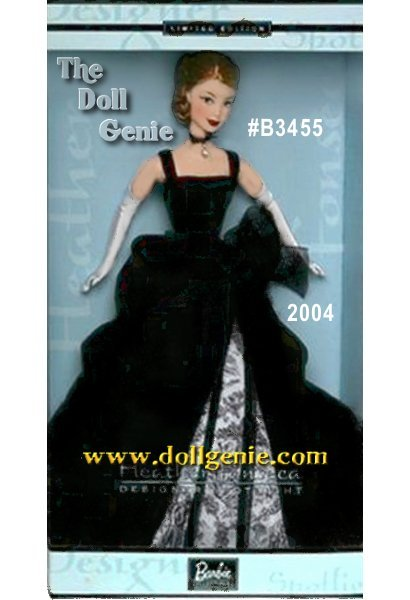 The Designer Spotlight series features the unique design aesthetics of Mattels most talented doll artists. Heather Fonseca created the second doll in the series and her love of art history is reflected in the elegance and classicism of this orginal design. Barbie wears an elegant floor length black gown that closes in the back with small snaps. The fitted bodice is made of black faille, trimmed with black velvet ribbon. That same ribbon is used as shoulder straps for the gown. The top skirt is made of black panne velvet with multiple bustles on the right side, creating a flowing and full effect. This top skirt is longer in the back, forming a subtle train. The top skirt is split in the front at the waistline to reveal a black and off-white foile print taffeta underskirt. Accessories include black spiked pumps, long stretch charmeuse gloves in natural white, and a black ribbon choker necklace tied in a small bow in front, accented with a delicate silver rhinestone.