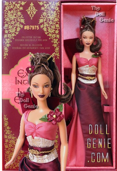Exotic Intrigue Barbie doll invites you to a place of pure perfection. An intricate gown in rich shades of burgundy and coral features rich golden embellishments. A faux flower graces one shoulder while an oversized bow completes the gowns back. The striking upswept hairstyle is held in place with golden sticks and decorated with another flower. Long, golden earrings complete the exquisite ensemble.