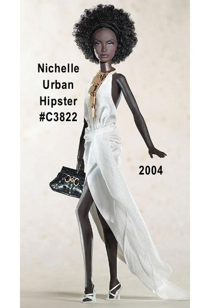 Nichelle Urban Hipster doll is breathtaking in a striking white polyester taffeta halter dress, embellished with a flowing, crinkle chiffon sash. High heel sandals are the perfect footwear. Her black embossed leatherette purse features golden studs and a fancy finding. An elaborate golden necklace is the final, fabulous accessory. Limited Availability - Hard to Find - designed by Robert Best