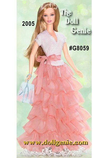 Birthday Wishes Barbie doll celebrates a very special event! Just a little bit formal and beautifully feminine, Barbie doll wears a floor length skirt of cascading peach chiffon ruffles with a sweet white lace wrap-over top and a peach chiffon tie. A delicate hair ornament with faux pearls is the final sweet detail. Comes with a beribboned gift bag, too.
