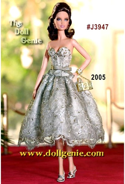 In a starring role destined to reach legendary status, Judith Leiber Barbie doll takes to the red carpet and captures all the glamour and prestige. A timeless classic thats always on trend, the name Judith Leiber inspires a dazz-worthy accoutrements include a golden minaudiere accented with clear and light topaz-colored crystals and a Barbie B logo, leaf motif earrings, and golden cuff bracelet with set-in crystals!