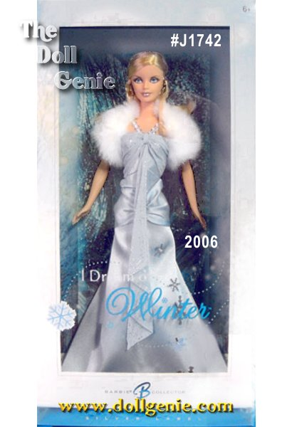 Each season has unique signs and symbols. The magic of winter inspires this cool, blonde beauty wearing a long, ice blue charmeuse gown. It has a silvery, glitter printed ice blue chiffon halter with exquisite silvery seed bead detail-fur stole and silvery earrings the perfect accessories to complement winters elaborate display!