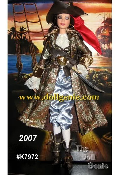 Ahoy, mates! The Pirate Barbie doll is a real treasure in this arresting example of swashbucklin style. Dressed in a beautiful brocade coat, velvet breeches, and plenty of ruffles and lace, our stylish captain is ready to take on the raging sea. Pirate-worthy accessories like buckled boots, sword, tri-corner hat, red bandanna and single golden hoop earring  complete this swift and saucy buccaneer look. Less than 9,300 worldwide