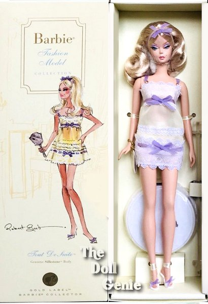 Oh-la-la! Barbie doll looks absolutely adorable in flirty pale yellow pajamas with lavender ribbon accents. Light cream pumps with lavender bows complete the bedtime ensemble. Serene face paint and long blond hair held back by a matching lavender ribbon make the doll look even more delightful. Less than 18,500 worldwide