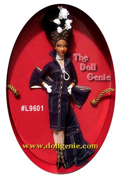 Look out! This fierce fashionista Collector Club Exclusive, the third doll in Byron Lars Chapeaux Collection, is a force to be reckoned with. From the couture coat with high fashion accents including a high collar and a dramatic bow that turns into a train in the back to stylish tan pants and gloves, fishnet stockings, severe high heels, and faux pearl necklace, every detail on this doll captures her exquisite essence. Check out the wild updo hairstyle, complete with stylish hat perched atop it!