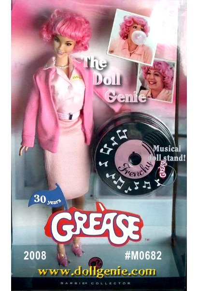 This cute Frenchy Barbie doll wears a reproduction of the costume from the Frosty Palace scene where Frenchy bemoans being a beauty school drop-out. Is her pink hair a sure sign that she has not made a strategic career move or will a heavenly teen angel guide her to a wise educational choice Stay tuned!