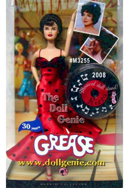 Grease is the word! This doll captures the heart and soul of the original bad girl and head of the Pink Ladies. From the short sassy hair to the flirty fitted red dress with black polka dots to her fantastic face paint, every detail epitomizes Rizzo as she makes a splashy entrance at the National Bandstand Dance Off. Designed by Bill Greening.