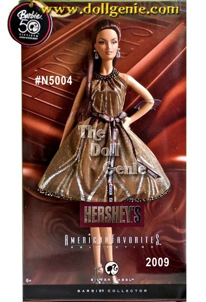 American Favorites Series - For well over a century, Hersheys has been the chocolate of choice. Now, Hersheys Barbie doll embodies the sweet style and classic appeal of the beloved Hersheys chocolate brand. Wearing a stylish brown cocktail dress complete with Hersheys ribbon around the waist, sky high heels, and sparkling drop earrings, Barbie doll looks absolutely delicious. Designed by Linda Kyaw.
