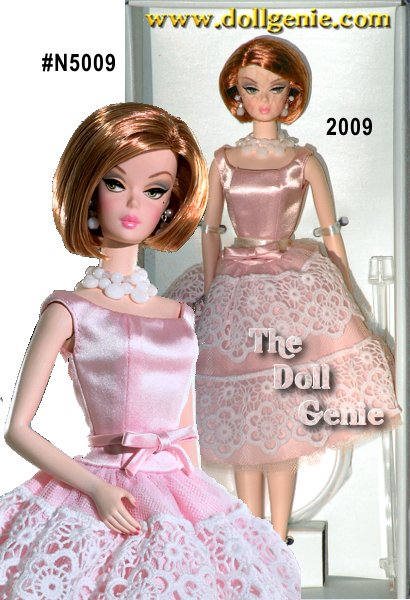 This is a reinterpretation of Plantation Belle, a favorite fashion from 1959.  This strawberry blonde is he epitome of southern charm in her pink satin ensemble with white cotton eyelet trim!  Delicate details include white tulle and late petticoat and white satin clutch purse. Designed by Robert Best - No more than 10300 units produced worldwide.