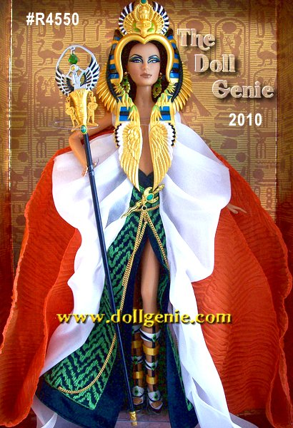 This striking portrayal of Barbie doll as Cleopatra captures the nobility of a divine queen. She wears a dazzling cape and skirt with exotic green and black design, featuring a golden rope embellishment. Her extravagant headdress lends a regal air with its ornate design with scarab and cobra details. The faux jewel and golden earrings, dagger, and scepter reveal the pharaohs exotic origin. History and striking elegance meet to create an extraordinary doll. Designed by Linda Kyaw
