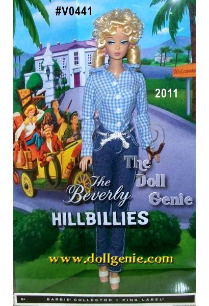 The Elly May Barbie doll captures the essence of the classic 60s TV character and show, The Beverly Hillbillies. Elly May Barbie doll features a vintage face with her trademark hairstyle and ribbon details. Sporting a gingham shirt, denim jeans and espadrilles, Elly May Barbie doll also comes with her infamous slingshot. Designed by Robert Best