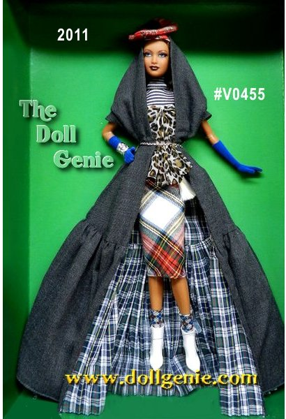 Byron Lars, Passport Series, Mackenzie Fenella Layla Barbie doll is a multicultural mash up with major couture cred! Combining Kente cloth from Nigeria with Scottish tartan, she wears a leopard print bodice over a stripped top with a red & green tartan skirt. For even more drama, she adds an exquisite grey cape lined in green and blue tartan, and tops it all off with a red tartan cap over her close cropped afro. Accessories include a traditional Scottish pouch and white ankle boots. With creamy coffee-colored skin, deep burgundy lips and rooted lashes, this lucky lass has a passport to funky fashion town in sensational style. Designed by Ann Driskill - less than 2,100 worldwide