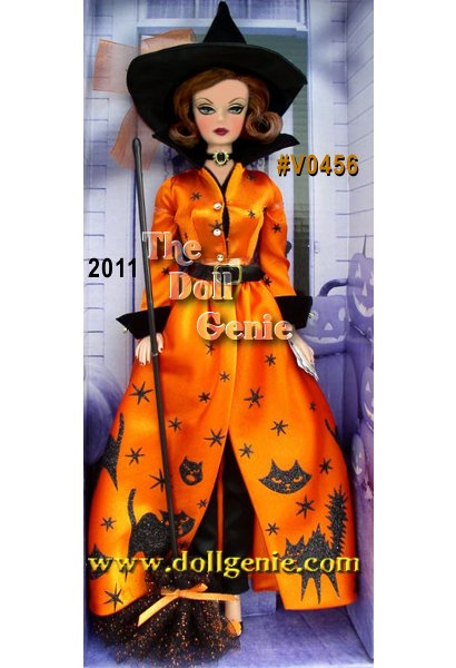 Designed by Bill Greening - No trick here... Halloween Haunt Barbie doll is a treat to behold! The perfect hostess, she is dressed for the occasion in a festive holiday outfit of orange, appropriately adorned with black cats and stars. She adds a wide waist-cinching belt with gold buckle, a black and gold choker, and basic black pumps accented with orange pompoms. Her black witch hat sits atop short auburn hair, and her vintage face sculpt features delightfully dark plum lips. A must-have holiday decoration for any Barbie doll devotee! Less than 3,100 worldwide