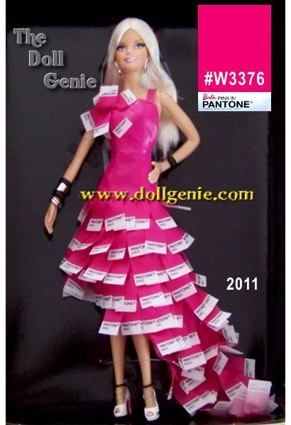 This Barbie is all about pink, particularly PMS 219, her signature color. This glamorous dress celebrates that fashion heritage with a long full skirt made of pantone color chips in PMS 219. The  leather bodice, also in matching pink, is sleek and fitted with two straps and a flower accent of pantone chips. White shoes, with PMS 219 written on them, silvery and black bangles and silver hoop earrings complete the look. Pink has never looked so pretty. 15100 worldwide