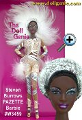 A flash of feathers, a sprinkling of sequins, and daring design elevate one stylish woman to fashion icon status. Inspired by the dazzling world of a retro showgirl, she makes a show-stopping entrance that wows any audience from the catwalk to the stage and beyond!  Stephen Burrows Pazette Barbie doll, created by the renowned designer, wears an extraordinary ensemble that stuns with silvery glitter, rhinestones, and sequins. The luscious shade of nude plays against beautiful deep skin tone and black hair pulled into an elegant chignon. A silvery headpiece features a cascade of white feathers.
