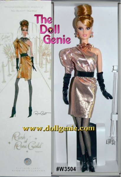 Striking and sophisticated, Rush of Rose Gold Barbie doll is stunning in an asymmetrical dress of glamorous golden lame. A single dolman sleeve makes a bold statement, while the wrap skirt falls just above her knees, adding to the modern silhouette. The black vinyl belt, hose and boots offer elegant contrast, while rose-golden accessories add the final stylish touch. Limited Platinum Edition by Robert Best - Because this is a BC Exclusive doll, this doll was only available to us through resale and is priced accordingly. Less than 1000 of these dolls worldwide.