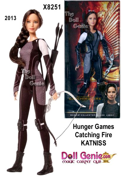In Catching Fire, last year's victor, Katniss Everdeen, must once again compete for her life in the 75th Annual Hunger Games, also known as the Quarter Quell. This doll is the first sculpted to the likeness of Jennifer Lawrence. Inspired by the outfits worn by Tributes at the start of the competition, Katniss wears her signature long braid and is dressed in a futuristic body suit with knee pads, elbow guards and short boots. A quiver of arrows is slung across her shoulder and her silvery bow is ready to take aim. This image is from the Hunger Games Catching Fire Movie Promo material and modified to include the item code numbers of the Mattel dolls to be released this fall.
