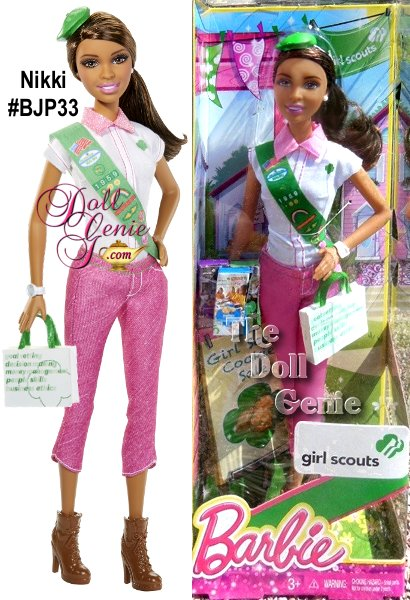 African American NIKKI Girl Scout Barbie Doll - This keepsake doll wears a Girl Scout-inspired outfit with plenty of Barbie signature style(think lots of pretty pink touches). Sweet accessories include a Girl Scout sash with insignia and badges, charming green Girl Scout beret, mini boxes of everyones favorite Girl Scout Cookies and a handy bag imprinted with the 5 Skills girls learn through the Girl Scout Cookie Program. A pretty ponytail and hiking boots complete the fashionable look!