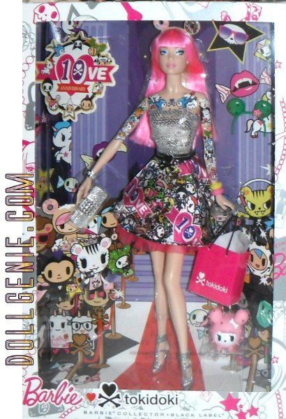 Dressed for a night on the town, TokiDoki Barbie Doll wears a sequined top for some eye-catching sparkle. Once shes caught your attention, you will be captivated by her intricate tattoos, and the skirt that features many of the cute and whimsical characters that have inhabited the world of TokiDoki for 10 years! With her faithful Cactus Friend Polppetina by her side, she carries a chic silvery clutch and also comes with a TokiDoki gift bag. TOKI DOKI BARBIE limited quantities available.