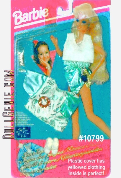 Sun Jewel Fashion Shimmering Swimsuit with blouse shoes and a blet that turns into a bracetlet with 3 charms (included) 1993 by MATTEL -packaging has yellowed.