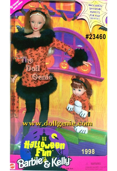 Barbie is pretty in her costume. A Tiger print dress with black fur at the collar, sleeves and hem. She's wearing black lights, a cute headband with ears and a tail complete her Tiger look. Kelly is in a tiger suit complete with white paws and tail. A headband with ears rest on her head. In her hand is a purple Trick or Treat bag.