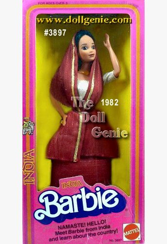 India Barbie doll looks elegant and enchanting in this traditional costume. She wears a three-piece sari, including a long rusty red skirt, matching wrap, both trimmed with golden thread, and golden halter-top. Her long brown hair is pulled back, accenting her delicate features.